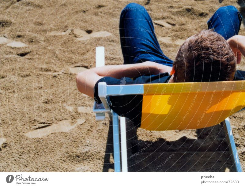 Man Ocean Summer Beach Vacation & Travel Hair and hairstyles Head Sand Jeans Italy Couch Deckchair Slouch