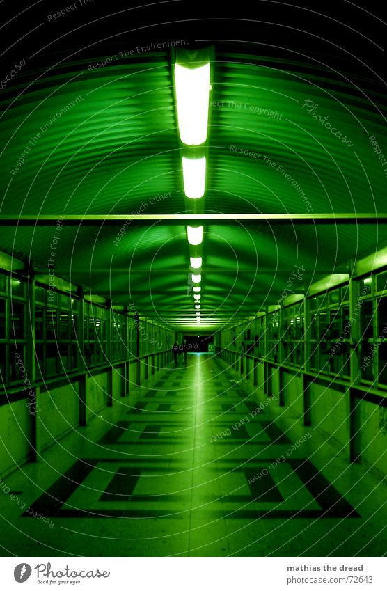 It's a long way to the goal. Friedrichshain Tunnel Tunnel vision Window Light Neon light Loneliness Symmetry Pattern Square Dark Dangerous Vanishing point Night