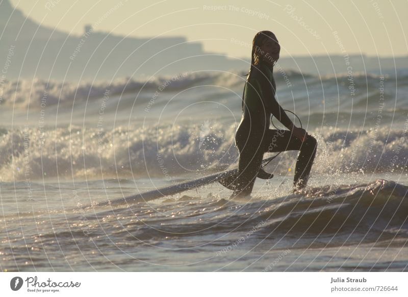 Surfer girl in the evening sun in white water Joy Leisure and hobbies Surfing Vacation & Travel Tourism Adventure Freedom Summer Summer vacation Sun Beach Ocean