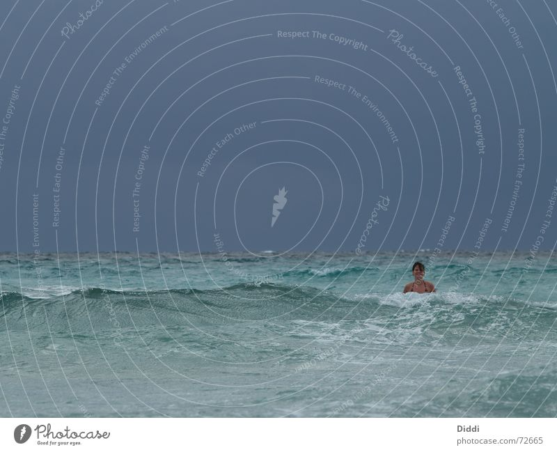 Alone in the sea Ocean Nixie (Water Spirit) Waves Vacation & Travel Surf Beach Woman Swimming & Bathing Freedom Loneliness Search Joy