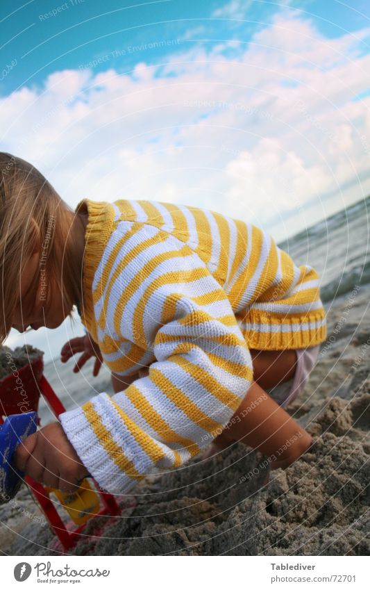 play <--> elements Child Toddler Girl Beach Sandy beach Lake Ocean Waves Clouds Bad weather Wind Passion Sandcastle Playing Go under Water Sky Beautiful weather