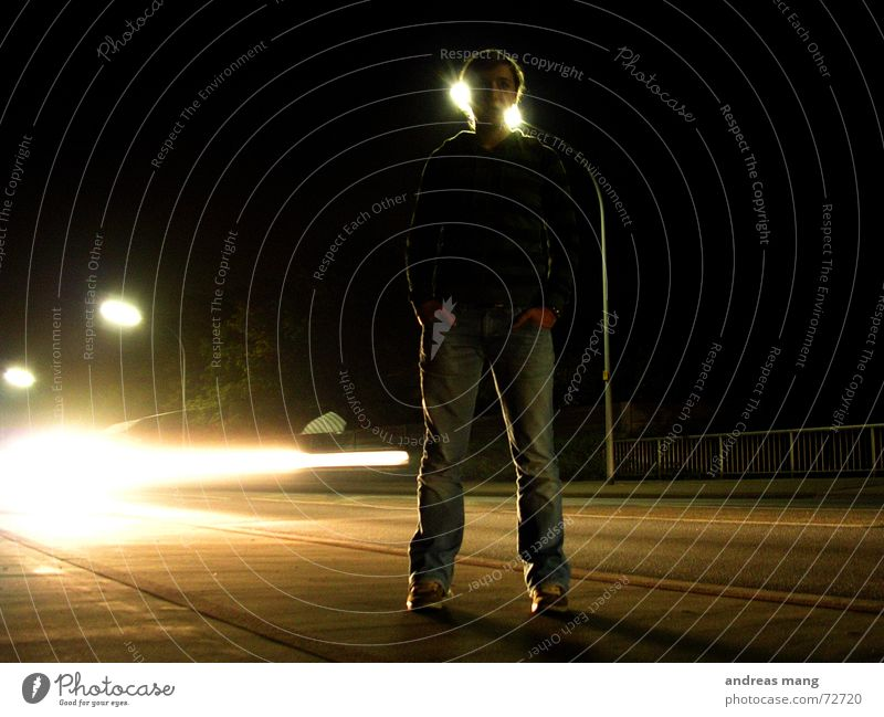 Standing at the road - Pt. I Light Woman Dark Stripe Street lighting Lantern Speed Loneliness Illuminate Lighting Edge Night standing Car motion Movement almost