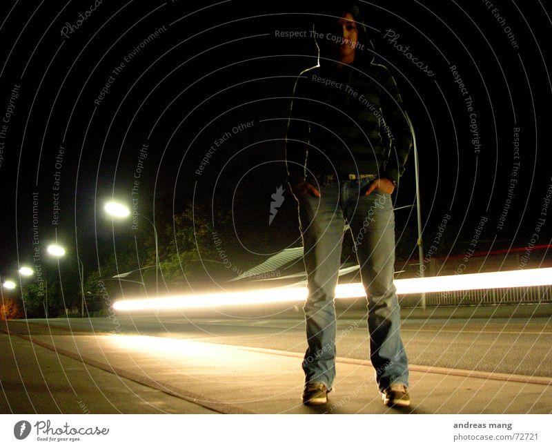 Standing at the road - Pt. II Light Woman Dark Stripe Street lighting Lantern Speed Loneliness Illuminate Lighting Edge Night standing Car motion Movement