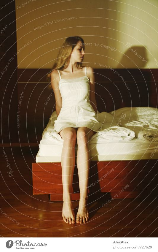 averted Bed Young woman Youth (Young adults) Legs Feet 18 - 30 years Adults Dress Blonde Long-haired Observe Sit Esthetic Large Thin Beautiful Athletic Emotions