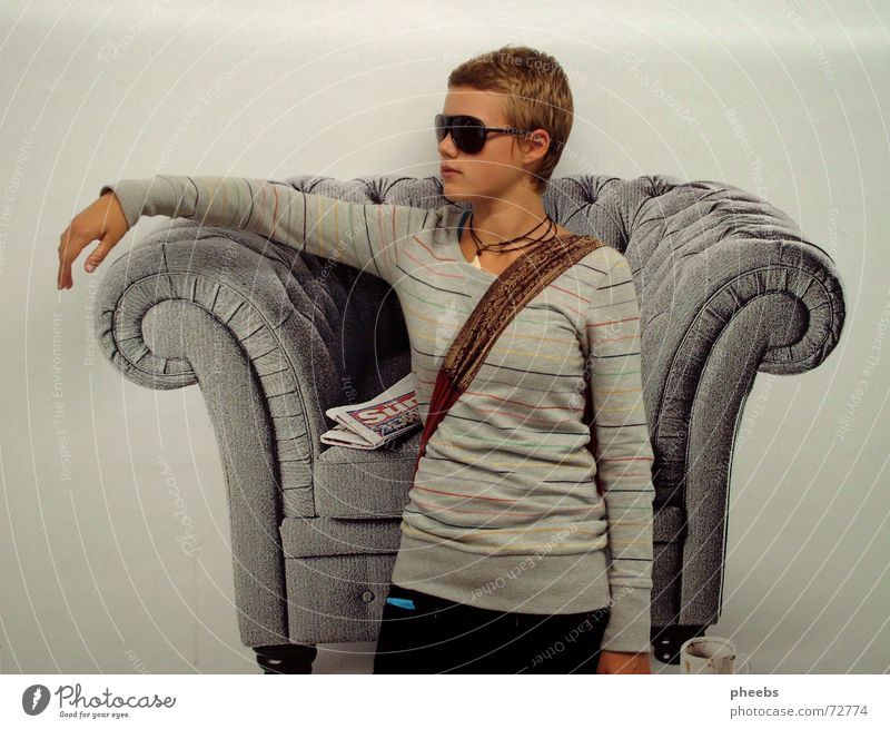 living room underground Poster Armchair Living room Woman Sunglasses Collage Background picture Underground London Underground Striped sweater Newspaper
