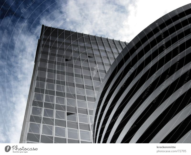 Cuboid and column Clouds House (Residential Structure) Building Window Reflection Large Glas facade Towering Height difference Sky Tall office building to tower