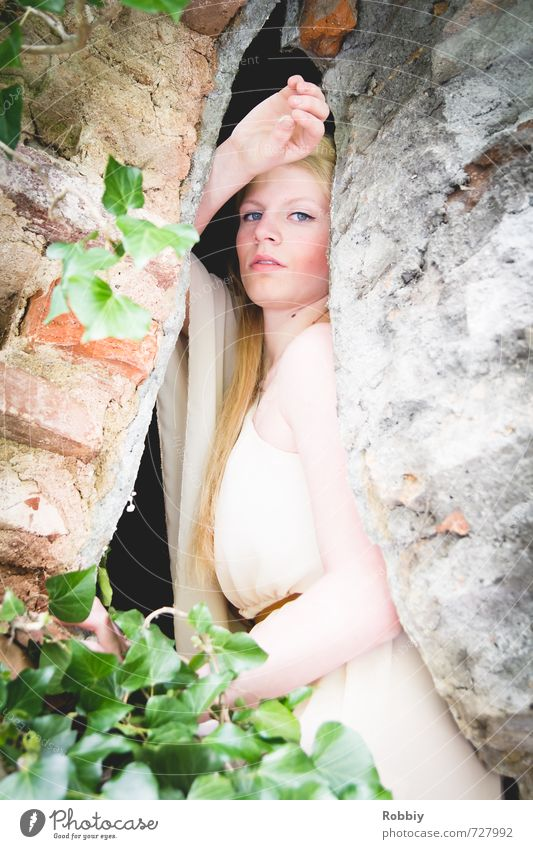 Rapunzel II Feminine Young woman Youth (Young adults) 1 Human being 18 - 30 years Adults Ivy Wall (barrier) Wall (building) Facade Dress Blonde Brick Stone