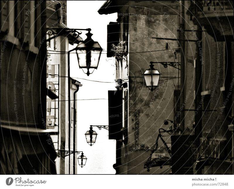 Old Lamp Window Facade Black & white photo Italy Narrow Alley Medieval times Sun blind Lake Garda