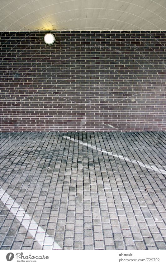 stones Building Architecture Wall (barrier) Wall (building) Facade Parking lot Lamp Brick Paving stone Stone Line Town Oil slick Patch Colour photo