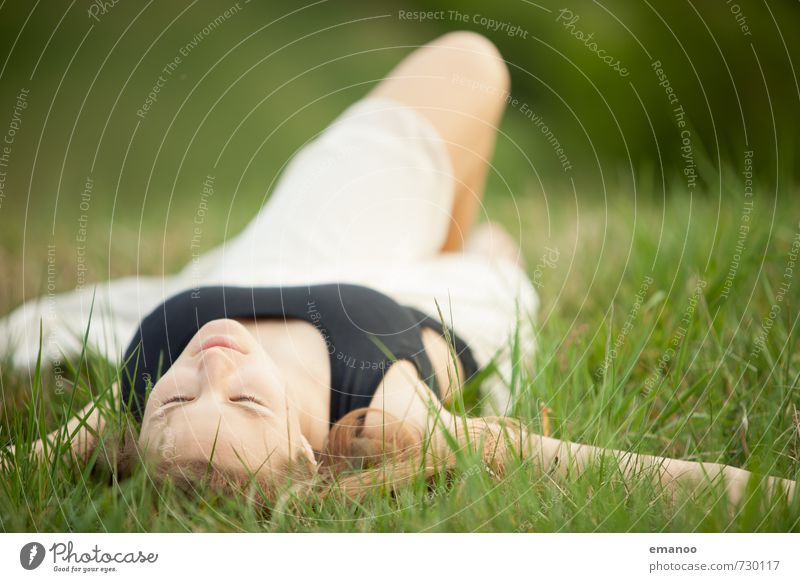 Young woman lying in the grass with her eyes closed Lifestyle Style Joy pretty Harmonious Well-being Contentment Relaxation Calm Fragrance Leisure and hobbies