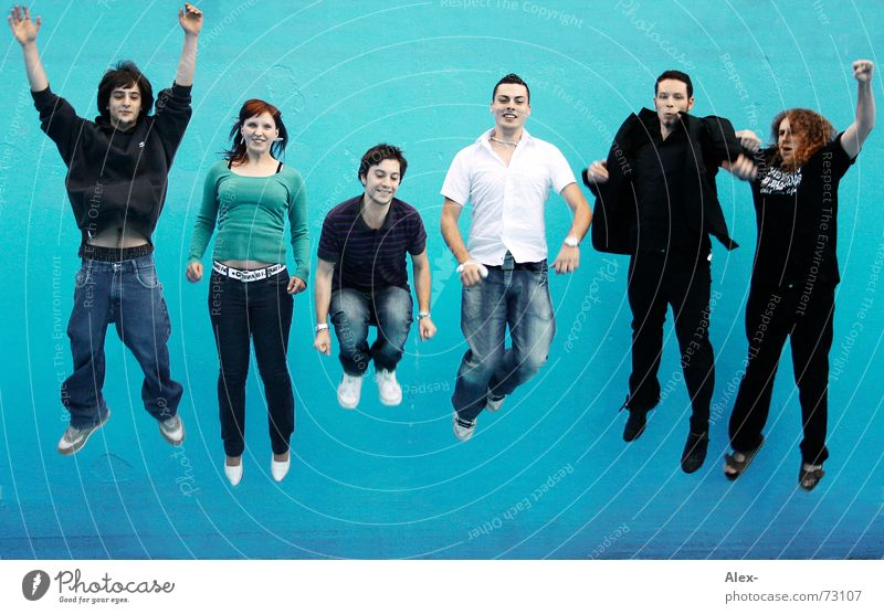 Woman Human being Man Youth (Young adults) Blue Joy Water Jump Laughter School Waves Funny Flying Swimming pool Target To fall