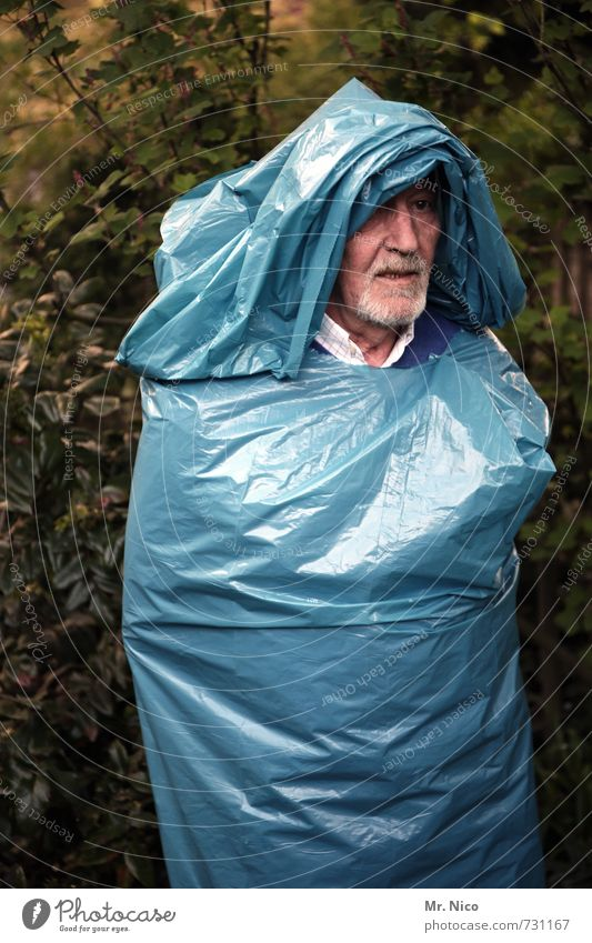 old bag Lifestyle Masculine Face Environment Tree Bushes Garden Park Facial hair Trashy Crazy Blue Garbage bag Hooded (clothing) Disguised Sculpture