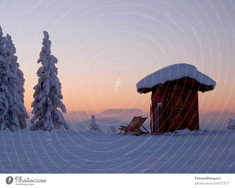 Evening impression on the mountain Snow Deckchair Coniferous trees Fir tree Color gradient Federal State of Tyrol Westendorf Sky Sunset Twilight Mountain Hut