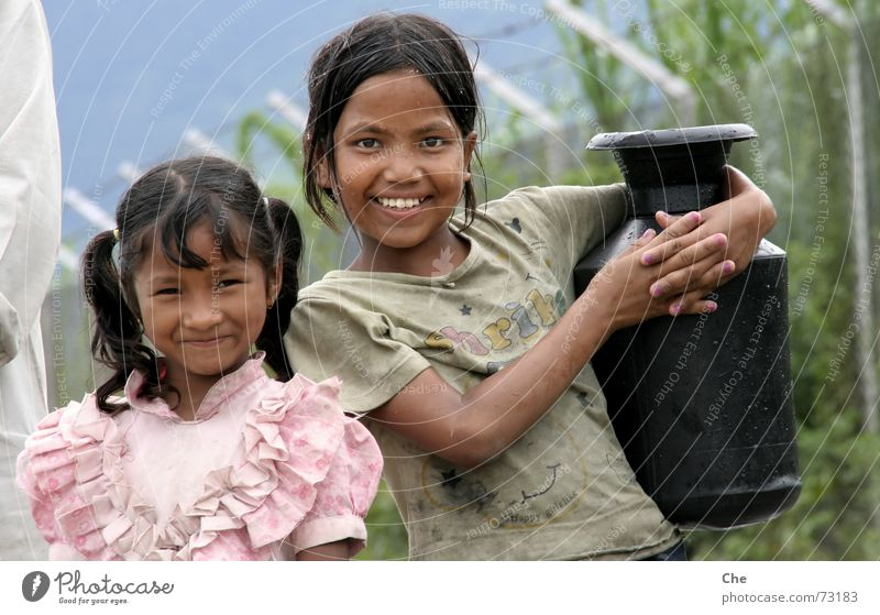 Small water carriers Water jug Nepal Child Friendship Brothers and sisters Sister Wet Chic Beautiful Dirty Heavy Asia Household Laughter Work and employment