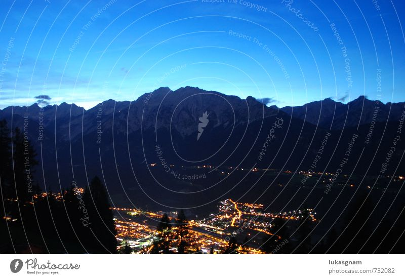 Innsbruck by night Nature Landscape Night sky Meadow Field Forest Rock Alps Mountain Adventure Colour photo Exterior shot Experimental Deserted Copy Space left