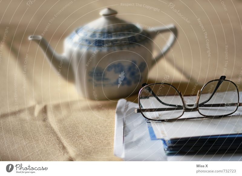 tea time Beverage Tea Well-being Relaxation Calm Leisure and hobbies Reading Table 60 years and older Senior citizen Eyeglasses Paper Emotions Moody Serene