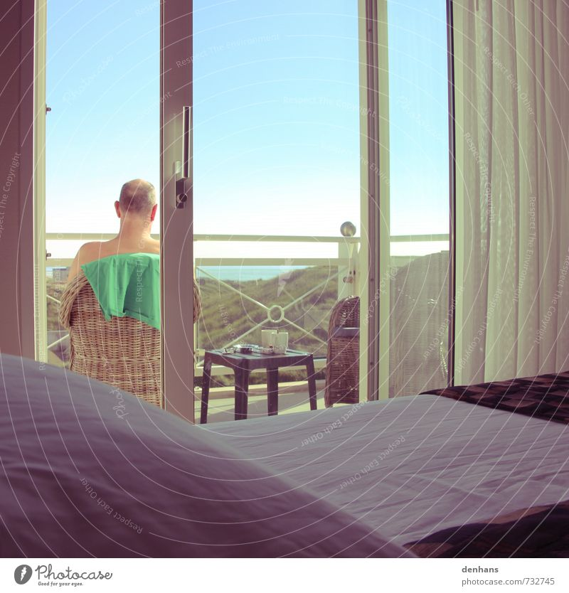 with sea view Luxury Sun Ocean Armchair Bed Bedroom French windows Balcony Man Adults 1 Human being 45 - 60 years Cloudless sky North Sea Beach dune
