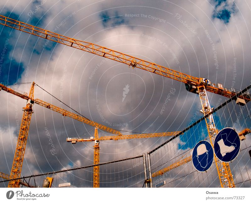Sky Clouds Safety Construction site Steel Fence Boots Barrier Crane Helmet Half-timbered facade Hoarding Working shoes Outrigger