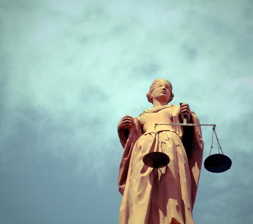 Justitia in a cloudy sky Justice Sculpture Statue Monument Dress Scale Stone Fairness Advice Stand Argument Famousness Blue Virtuous Truth Honest Wisdom