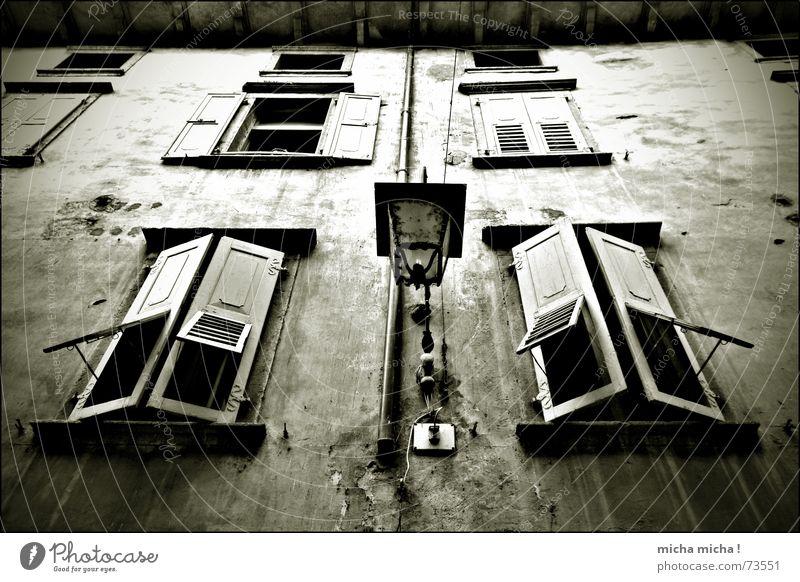 Bleak House I Dark Eerie Window Shutter Wood Facade Lamp Italy Lake Garda Alley Decline Arco maroon Mediterranean