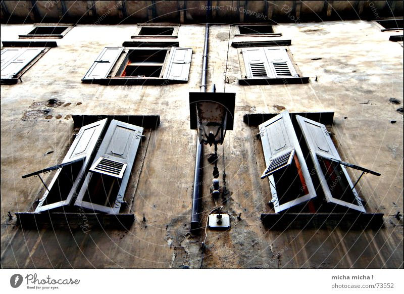 Bleak House II Dark Eerie Window Shutter Wood Facade Lamp Italy Lake Garda Alley Decline Arco maroon Mediterranean