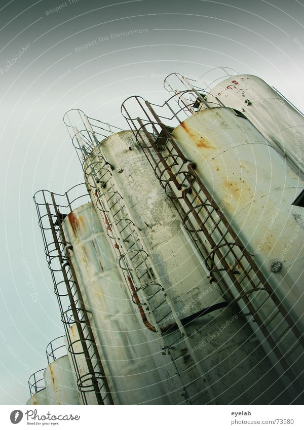 Silo rotting together Gray White Sky Industrial Photography Steel Round Rust Grunge silage grey steps Stairs Grain Metal Old Trashy Dirty