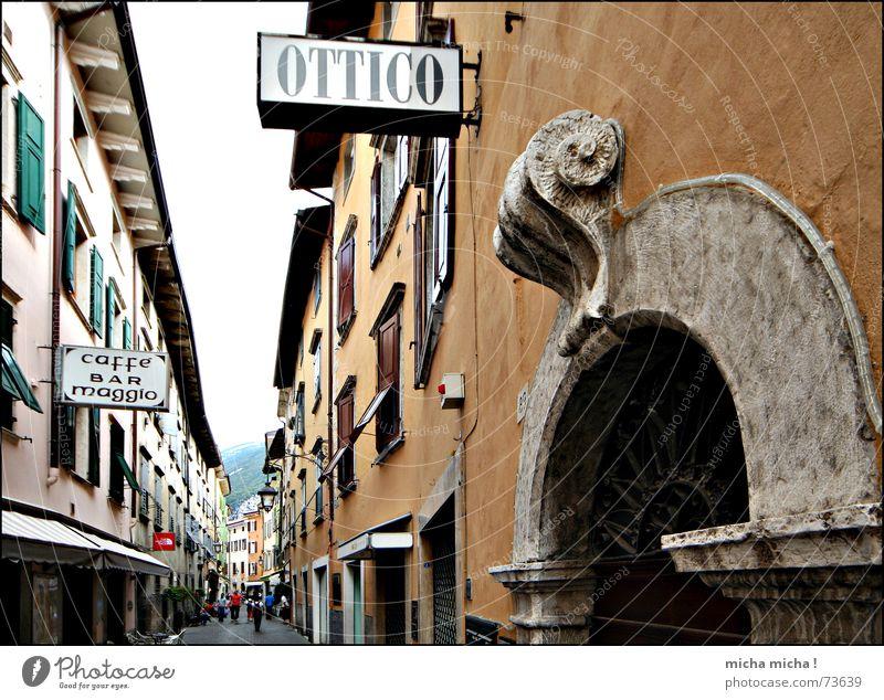 Ottico Alley Italy Lake Garda Narrow Multicoloured Window Shutter Human being To go for a walk Facade Mediterranean Arco Escape