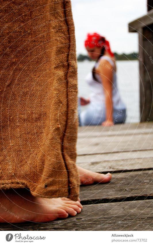 Hans gets close to Grete Footbridge Wood Man Woman Pants Brown Red Headscarf Barefoot Exterior shot Imitate Water Rope Feet creep up hans & grete