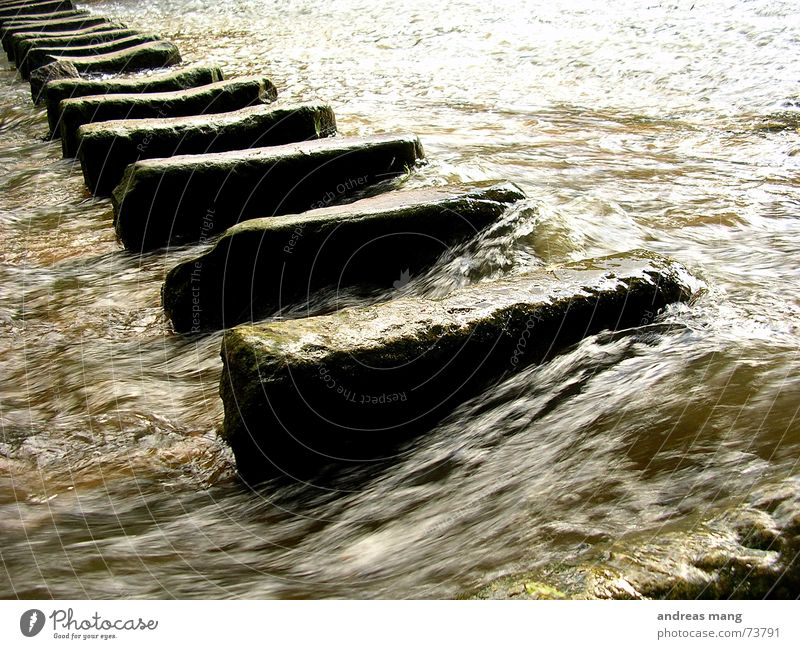 CROSSOVER Flow Current Dirty Traverse Rapid Dangerous Electricity River Water Stone stones cross over Above danger Threat