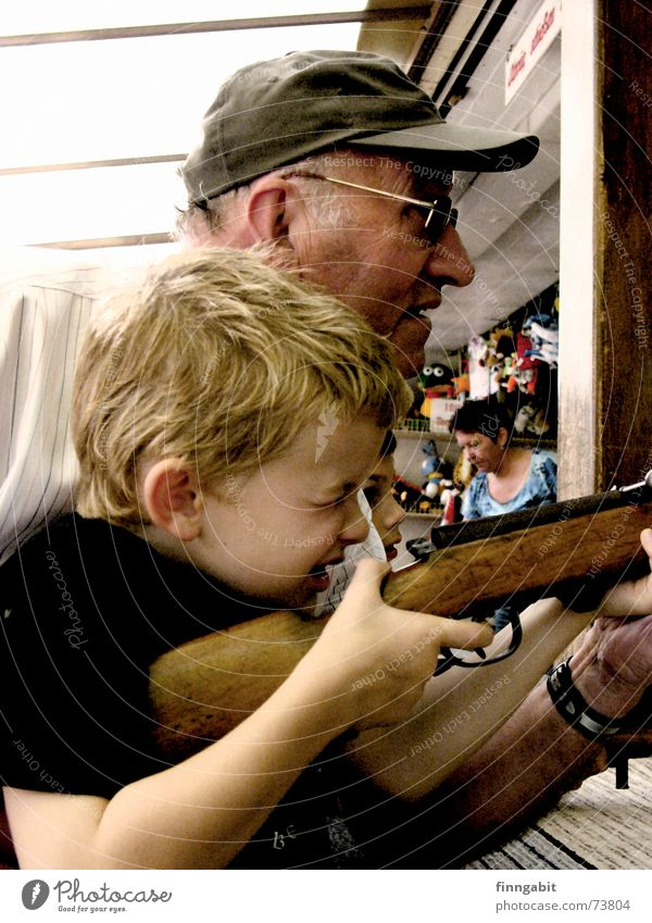 sniper Shooting gallery Rifle Airgun Marksman Grandfather Fairs & Carnivals Exterior shot shooting range grandpa and grandchildren old and young little boy fair