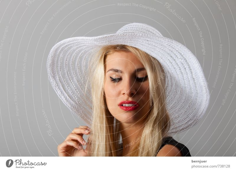 Hat is good Lifestyle Elegant Style Lipstick Mascara Human being Feminine Young woman Youth (Young adults) Head Hand 1 18 - 30 years Adults Listen to music