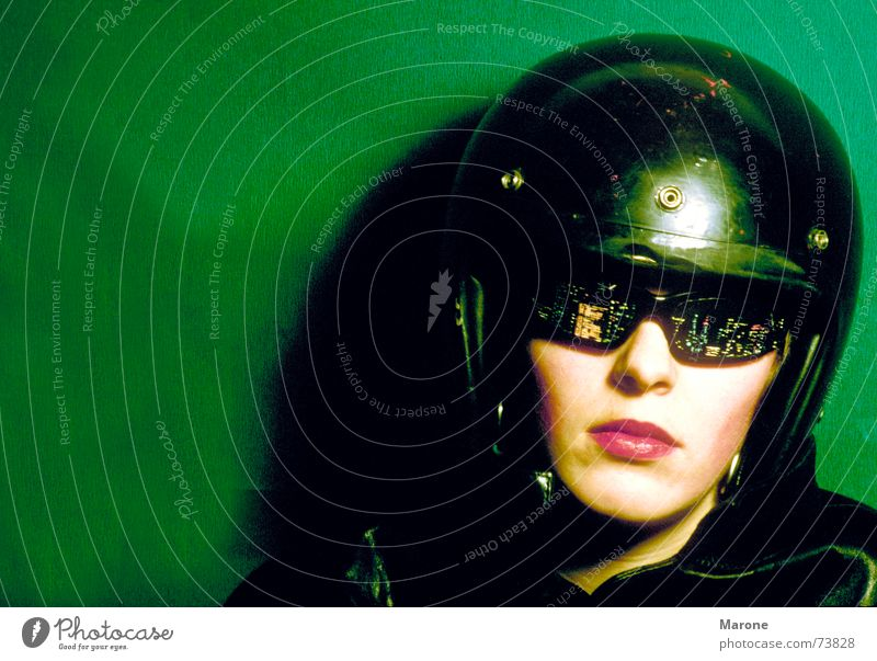 night glasses Facial expression Indifference Motorbike helmet Steadfast Portrait photograph Eyeglasses Helmet Woman Green Black Reflection Vantage point Face