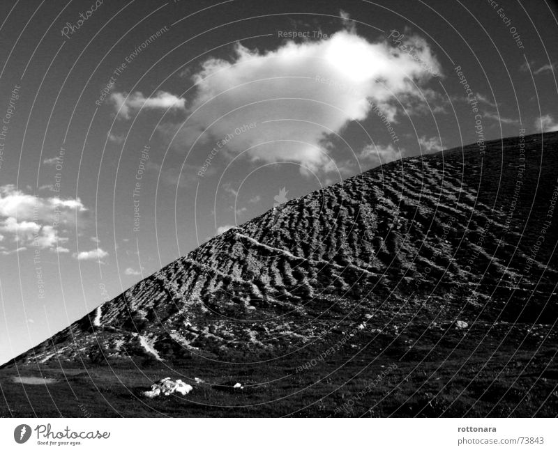 Heaven and earth Clouds Gray Air Meadow Alpine pasture Dolomites South Tyrol Italy Sky Earth Landscape Black & white photo Curve Nature Stone ladinia