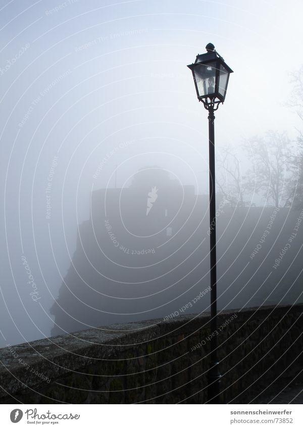 Lantern post at the Pozzo di San Patrizio in Umbria Lamp post Fog Dark Vantage point Exterior shot Sadness