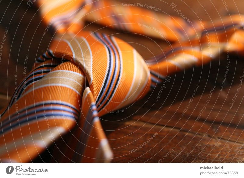 discarded Tie Wooden table Remote Pattern Mount Olympus Silk Stripe Store premises Reliability Work and employment Clothing Man Knot choke Desk Orange