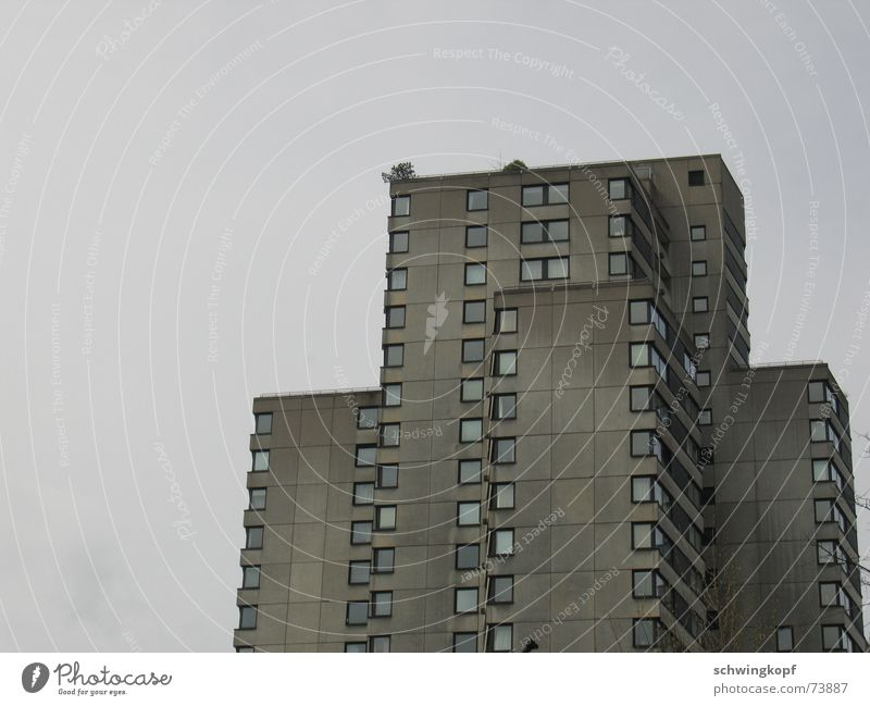 House in grey High-rise Window Story Gray Gloomy Dreary Settlement Facade Balcony Concrete Square Flat (apartment) Suburb Weather Shabby Patch terrace Sky