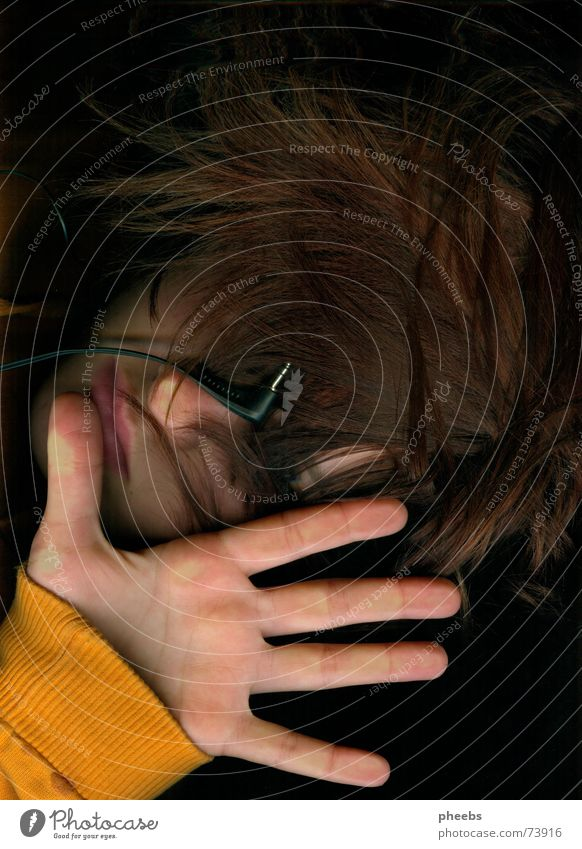 who wants to hear needs to feel, doesn't he? Headphones Scanner Hand Sweater Palm of the hand Hair and hairstyles Orange Music Amazed Face