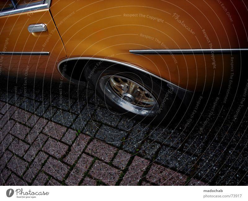Car Orange Leisure and hobbies Transport Floor covering Motor vehicle Metal Crate Door handle Carriage Chrome Stern Wood strip Driver Car driver Wheel rim