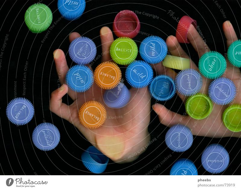 smarties? Hand Fingers Catch Dark Colour Advertising Minerals Mineral water Scanner Multicoloured