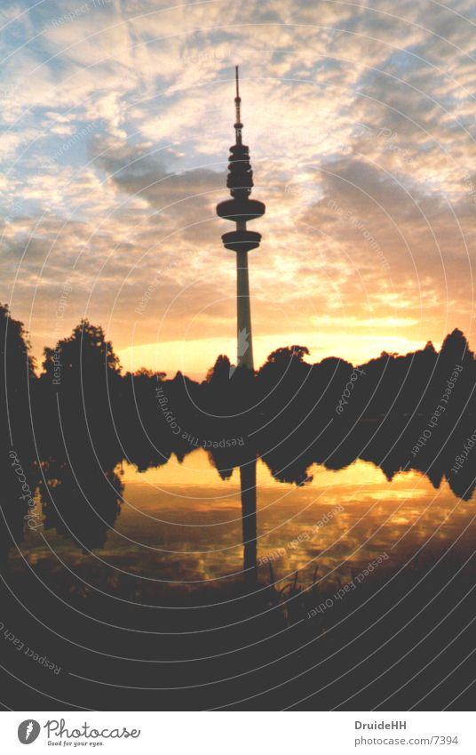 Sky Sun Clouds Yellow Europe Hamburg Dusk Television tower Mirror image Water reflection Cloud formation Hamburg TV tower