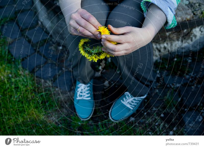 Young woman holds circlet of dandelion flowers in her hand Human being Feminine Youth (Young adults) Hand Fingers 1 18 - 30 years Adults Spring Summer