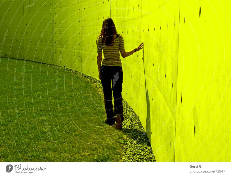 Woman Hand Wall (building) Wall (barrier) Bright Arm Going To go for a walk Thin Painting (action, work) Touch Expectation Long-haired Slowly Young woman