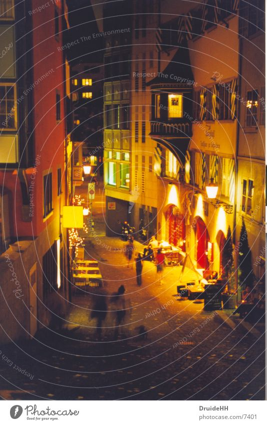 Zurich by night Night Dark Lantern Yellow Pedestrian Sidewalk café City life House (Residential Structure) Europe crap Lighting Movement