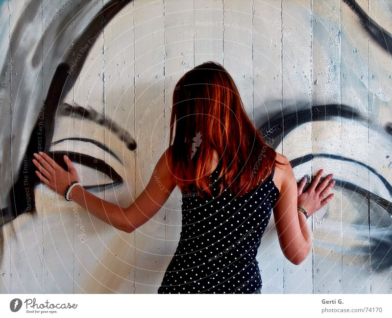 Woman Human being Hand Eyes Wall (building) Graffiti Wall (barrier) Arm Skin Back To hold on Hind quarters Painting and drawing (object) Rotate Long-haired