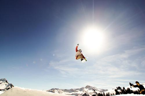 Jump to the sun Tourism Adventure Snow Winter vacation Sports Snowboard Sporting Complex Ski run Human being Masculine 2 To fall Athletic Blue Yellow Black