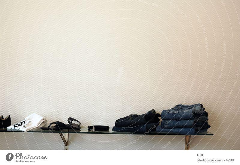 wall-mounted shelf unit Shelves Wall (building) Clothing Textiles Folded Footwear Belt Pane Jeans T-shirt Glass