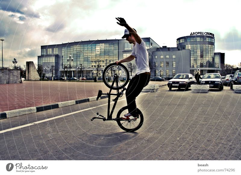 bmxzone.ru man #1 BMX bike flatland building Bicycle noon outdoor shooting town