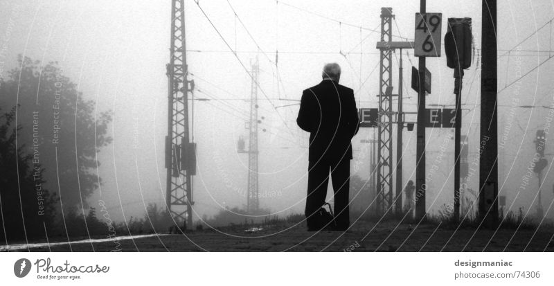 Waiting at the station Bensheim Gray Fog Cold Black Dark White Railroad Platform Man Stand Reading Suit Morning Late Time Gloomy Railroad tracks Grief Lateness