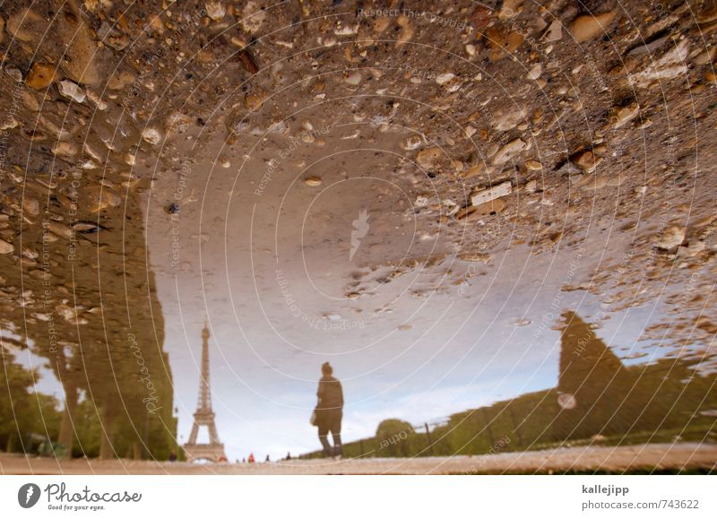 daydream Tourism Sightseeing City trip Human being 1 Town Capital city Tourist Attraction Surrealism Paris France Puddle Water Tower Park Garden Stone