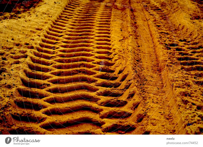 My tracks in the sand Tracks Relief Ochre Beige Yellow Pattern Excavator Sand Gold Construction site baaustelle gravel hollow